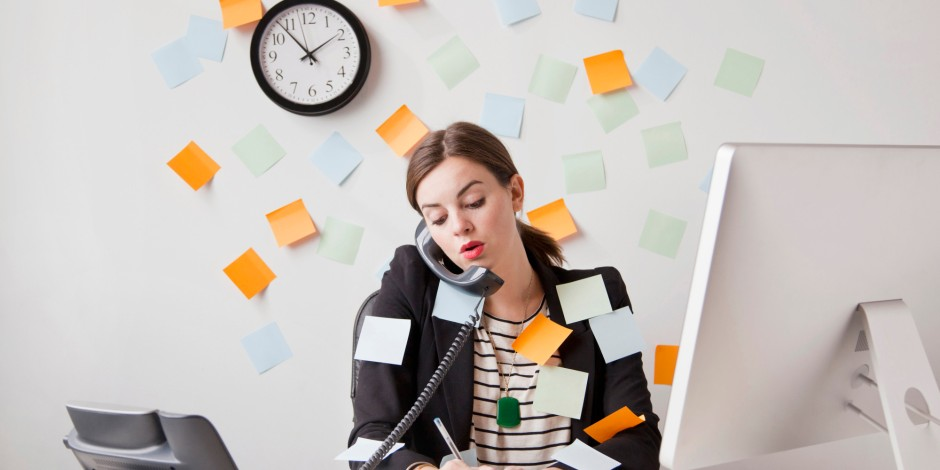 multitasking woman covered with post-it notes